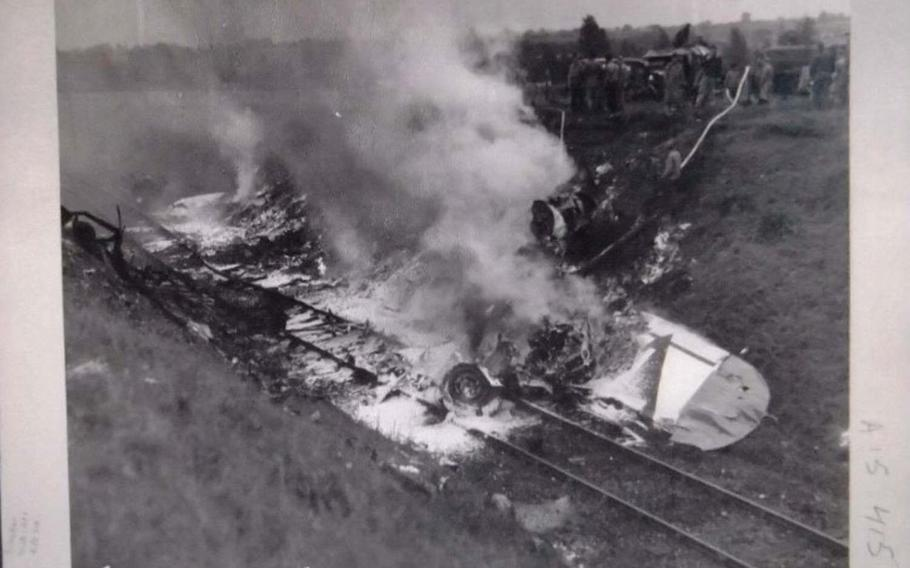 Photo of the crash of a B-17 Flying fortress named Smashing Thru in Ridgefield, England, July 13,1944. Eight crew members were killed as the plane skidded into an unseen railroad cut during an emergency landing.