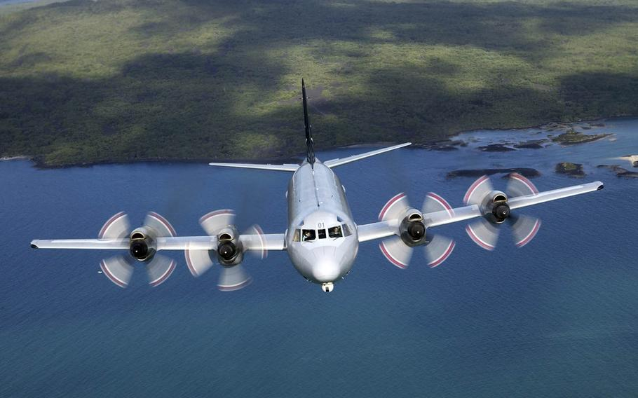 A P-3K Orion flies over Rangitoto Island near Auckland, New Zealand, in 2006.