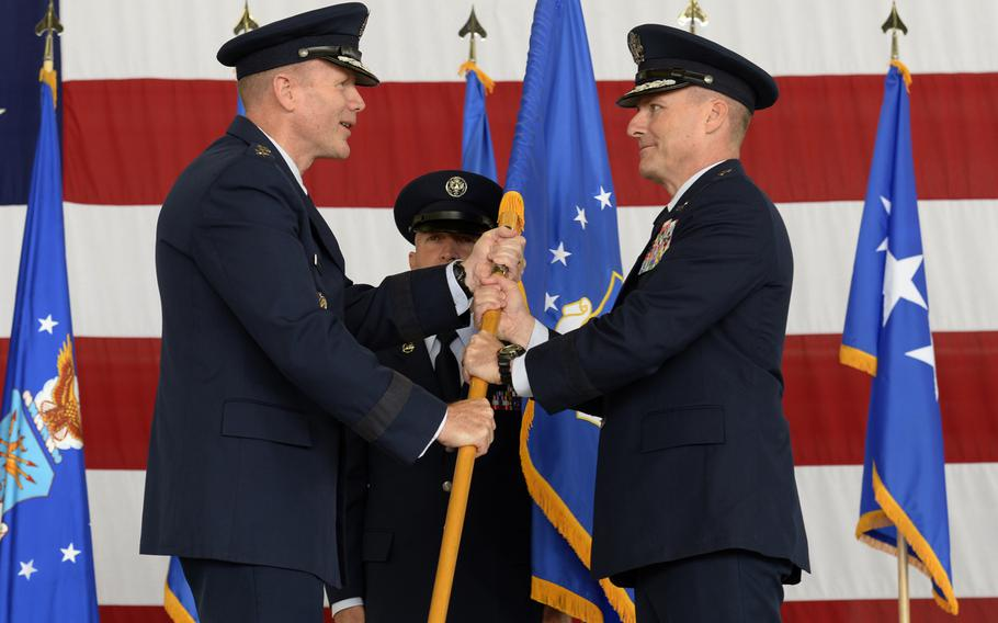 Gen. Tod D. Wolters passes the 3rd Air Force guidon to Maj. Gen. John Wood during the 3rd Air Force change-of-commander ceremony at Ramstein Air Base, Germany, Friday, Sept. 7, 2018.