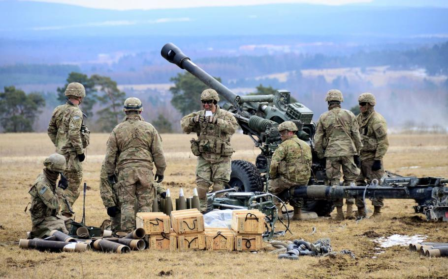 U.S. Army paratroopers assigned to Battery B, 4th Battalion, 319th Airborne Field Artillery Regiment, 173rd Airborne Brigade, prepare for a fire mission with M119 105 mm howitzers during an exercise, March 20, 2018. The Army  announced a plan Friday to add more firepower in Germany by creating new short-range air defense units, adding about 1,500 soldiers as well as their families by 2020.