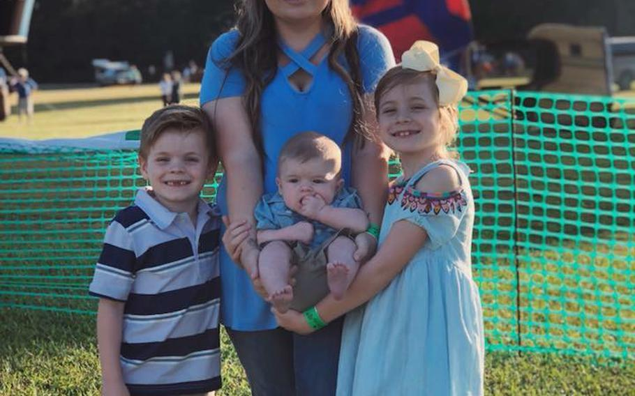 Pictured here in an undated family photo is Aaron McQueen and her children, left to right, Easton, Lucas and Leighton. Aaron McQueen's husband, Staff Sgt. Bryan McQueen, was injured Monday, Sept. 3, 2018, in an insider attack in Afghanistan's Logar province.