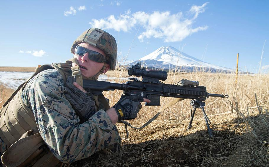 Cpl. Steven Moody engages his target downrange during a conventional platoon attack while training near Mount Fuji in Japan, Feb. 2, 2018.