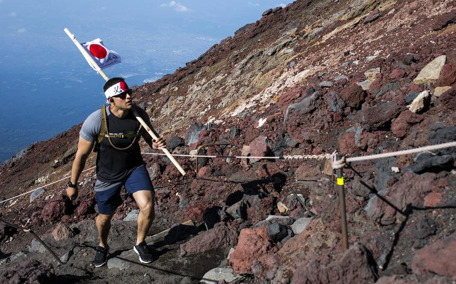 Marine Corps Staff Sgt. Camilo Gomez, an administrative chief with Marine Wing Support Squadron 171, climbs Mount Fuji, Aug. 2, 2018.