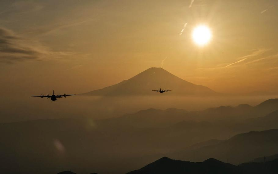 Two Air Force C-130J Super Hercules fly over Yamanashi prefecture, Japan, after conducting airdrop training missions, March 26, 2018.