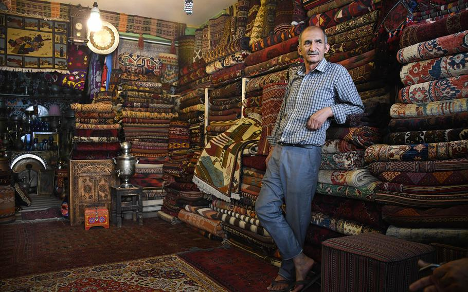 Sayed Jafar, a carpet salesman in Kabul, sells rugs commemorating the attacks of Sept. 11, 2001. As Americans commemorate 9/11, many Afghans either don't know much about it or do not believe the attack happened.