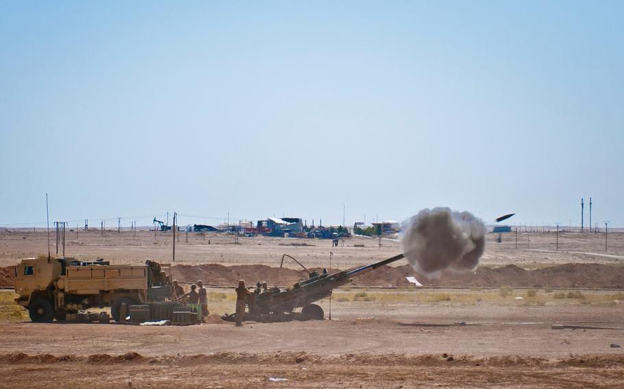 Coalition advisers turn their M777 Howitzer to prepare for a new fire mission at an outpost near Dashisha, Syria, June 9, 2018. The coalition has provided assistance and training to the Syrian Democratic Forces as they continue to reclaim their homeland from ISIS during Operation Roundup.