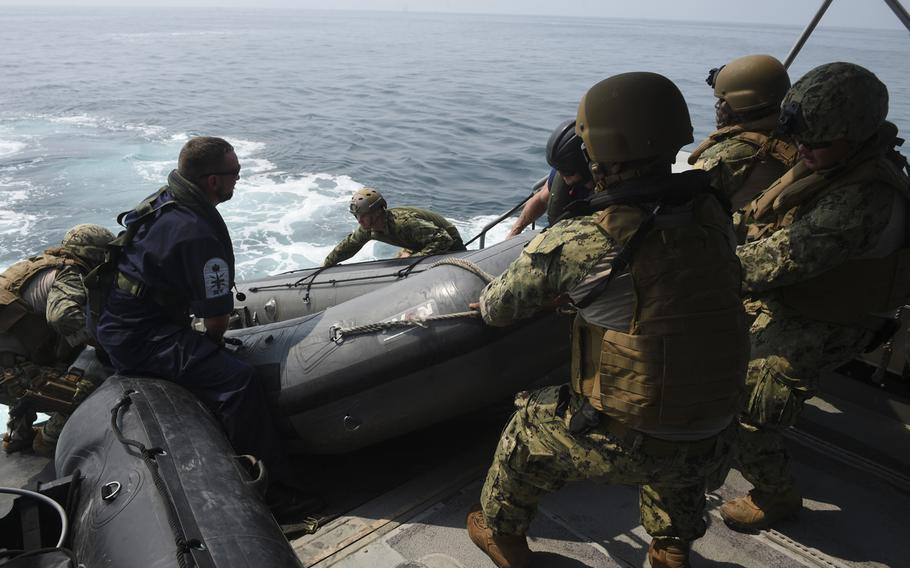 Sailors retrieve a rigid-hull inflatable boat in the Persian Gulf during Mine Countermeasures Exercise 18-3, Tuesday, Sept. 11, 2018.