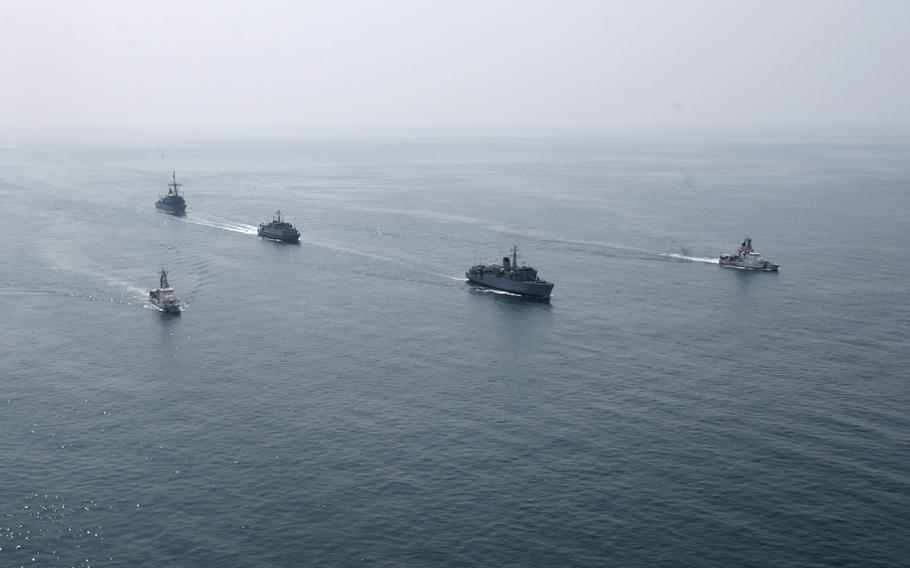 Navy minesweepers and Coast Guard patrol boats transit the Persian Gulf during Mine Countermeasures Exercise 18-3, Tuesday, Sept. 11, 2018.