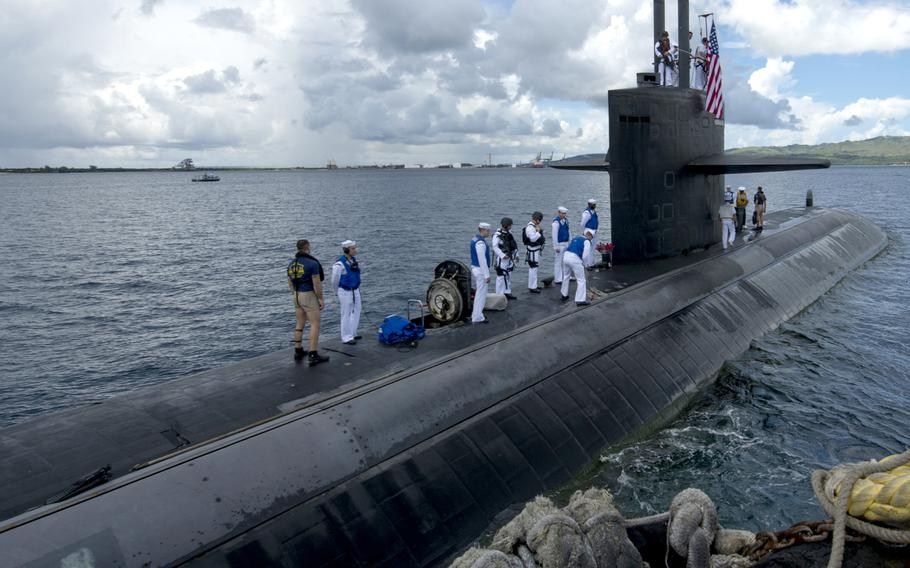 The Los-Angeles class fast attack submarine USS Oklahoma City returns to its homeport of Apra Harbor, Guam on June 29, 2018.