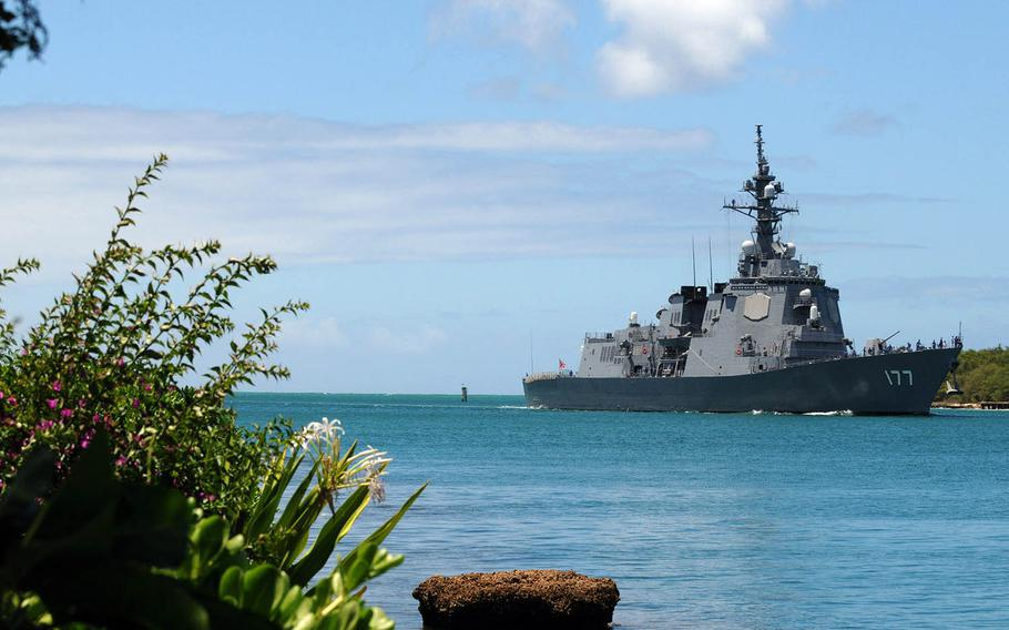 The Japan Maritime Self-Defense Force guided-missile destroyer JS Atago returns to Joint Base Pearl Harbor-Hickam, Hawaii, after participating in Rim of the Pacific sea drills in 2010.