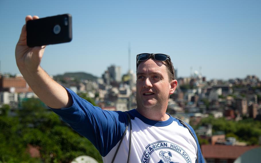 David Beard, 50, of Glendale, Ariz., takes a selfie at the the top of Yongsan Garrison in Seoul, South Korea, Sunday, Sept. 9, 2018.