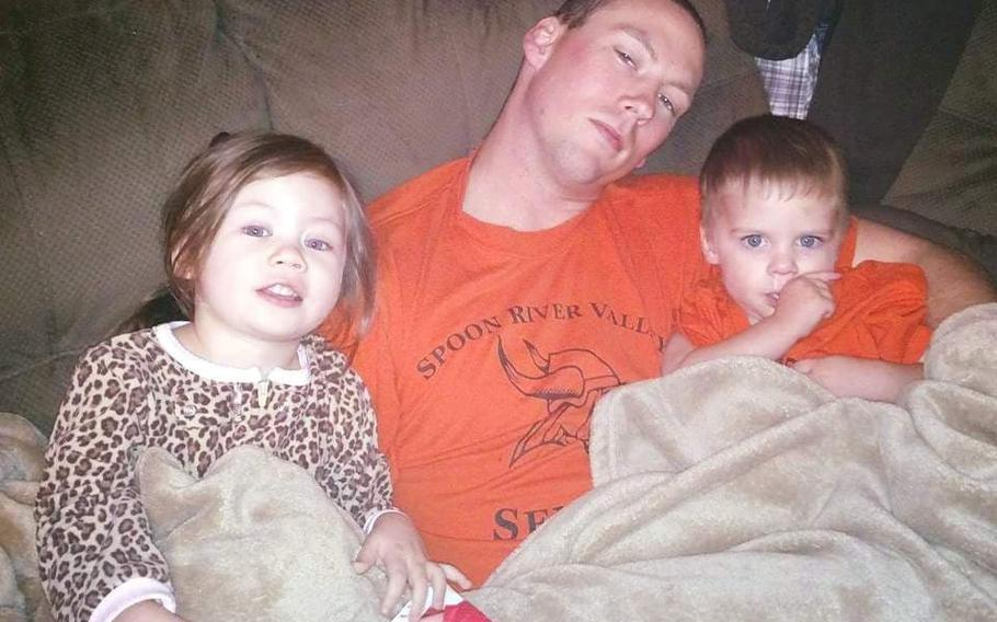 This undated family photo shows then-Cpl. Douglas J. Riney at home with his daughter, Elea, and son, James. Douglas Riney died on Oct. 19, 2016, of wounds suffered in an attack outside Kabul, Afghanistan. He was posthumously promoted to sergeant.