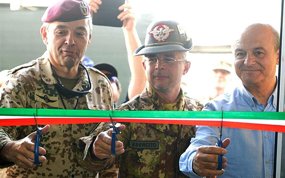 There was a ribbon cutting ceremony to inaugurate the newly constructed passenger terminal and tower for the Camp Resolute Support  helicopter landing zone in Kabul, Afghanistan, July, 16, 2018. The ribbon was cut, from left, by German army Lt. Gen. Alfons Mais, chief of staff NATO HQ Resolute Support, the deputy chief of staff NATO HQ Resolute Support Italian army Maj. Gen. Massimo Panizzi and NATO Support and Procurement Agency's diirector support to operations, Orhan Muratli.