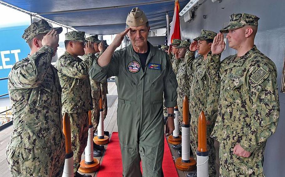 Vice Chief of Naval Operations Bill Moran salutes as he boards the 7th Fleet flagship USS Blue Ridge at Yokosuka Naval Base, Japan, Sept. 12, 2018.