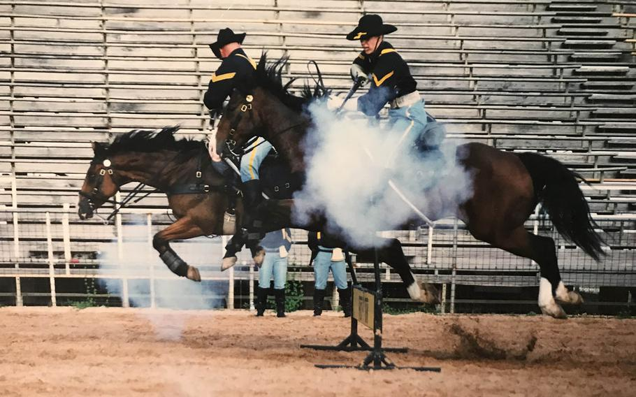 April Naiman rides Big Ben in a cavalry charge during her time as a trooper in the detachment from 2000 to 2004.