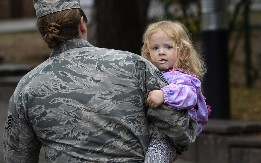 Staff Sgt. Symantha Schearer walks out of the Ramstein Child Development Center with her 3-year-old daughter, Aura, Thursday, September 13, 2018. Schearer said she was on the list for about a year before she got a spot at the CDC.