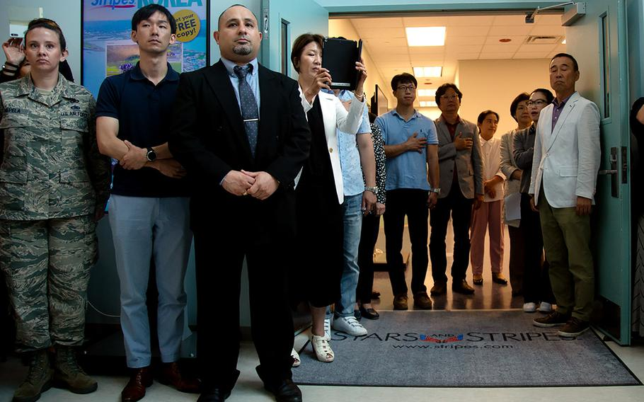 Stars and Stripes staffers attend a ribbon-cutting ceremony for the newspaper's new Korea headquarters at Camp Humphreys, Thursday, Sept. 20, 2018.
