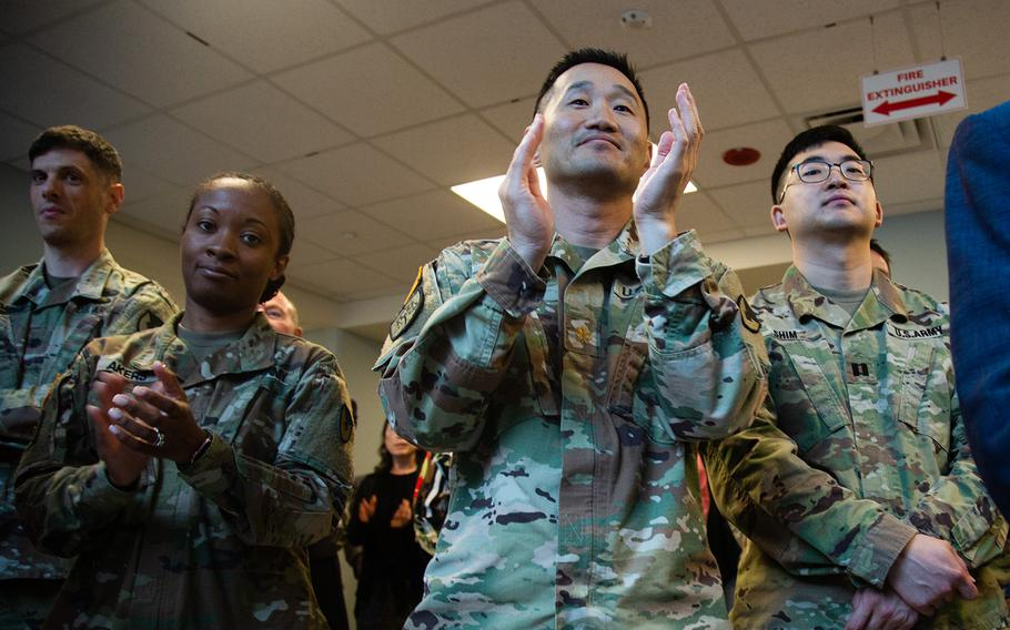 Soldiers applaud during a ribbon-cutting ceremony for Stars and Stripes' new Korea headquarters at Camp Humphreys, Thursday, Sept. 20, 2018.
