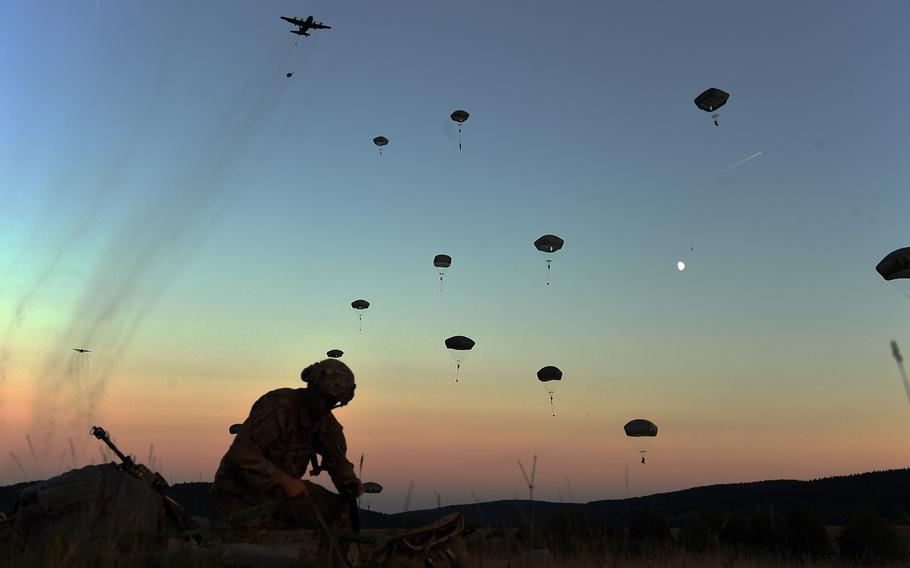A paratrooper with the 173rd Infantry Brigade Combat Team (Airborne) packs his parachute as more soldiers jump to the ground Wednesday, Sept. 19, 2018, during Exercise Saber Junction 18 at Hohenfels, Germany.