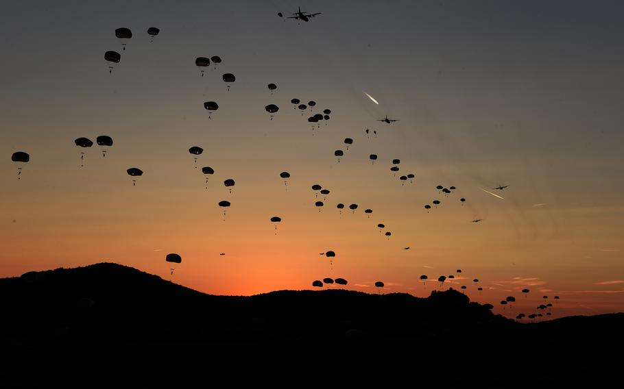 Paratroopers with the 173rd Infantry Brigade Combat Team (Airborne) jump at sunset, Wednesday, Sept. 19, 2018, during Exercise Saber Junction 18 at Hohenfels, Germany.