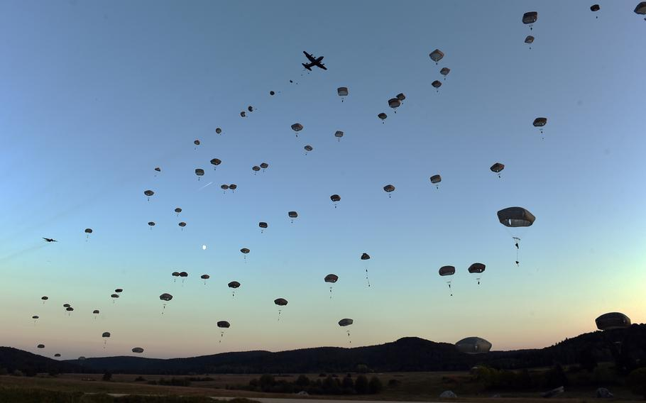 Paratroopers with the 173rd Infantry Brigade Combat Team (Airborne) jump to the ground, Wednesday, Sept. 19, 2018, during Exercise Saber Junction 18 at Hohenfels, Germany.