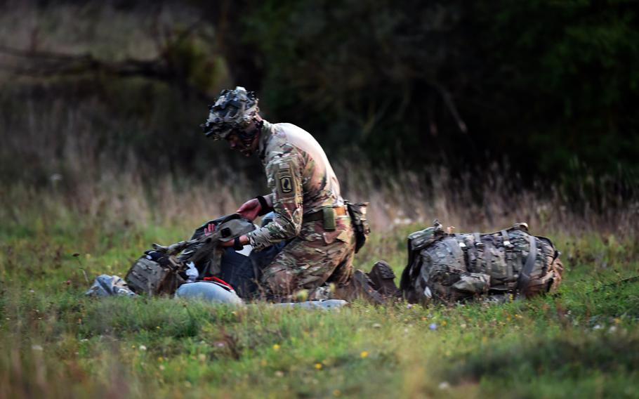 Capt. William Cordes, a battle captain with the 1st Squadron, 91st Cavalry Regiment, part of the 173rd Infantry Brigade Combat Team (Airborne), packs his gear after parachuting to the ground, during Exercise Saber Junction 18, Wednesday, Sept. 19, 2018, at Hohenfels, Germany.