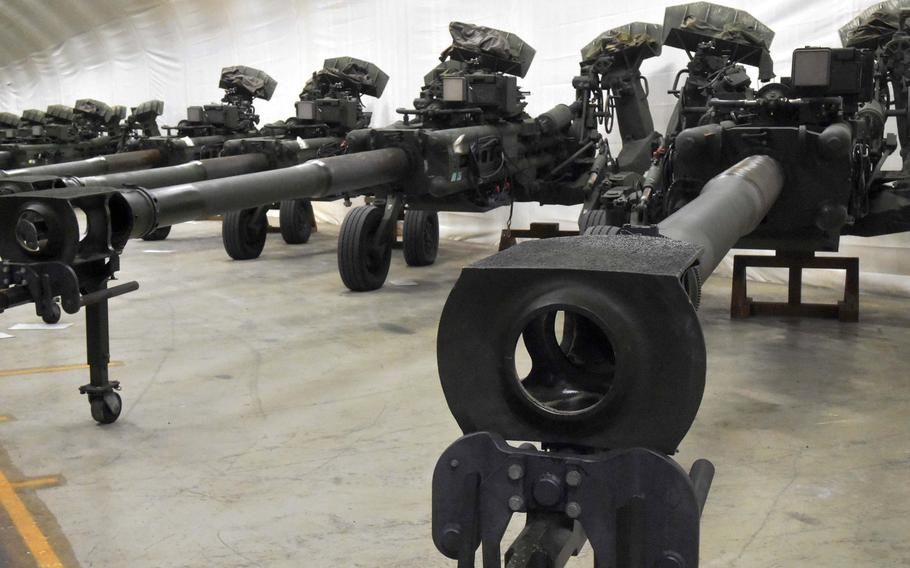 Marine 155 mm howitzers inside one of the Marine Corps Pre-Positioning Norway caves in the Trondelag region of Northern Norway, Friday, Feb. 2, 2018.  The Defense Department Inspector General found that some equipment isn't being properly stored and maintained in Europe.