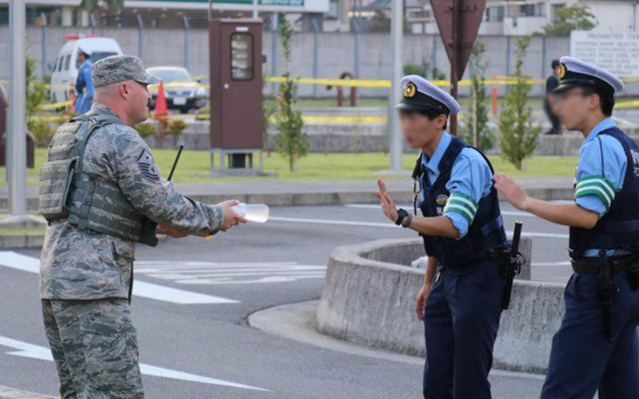 An airmen offers cold drinks to Japanese policemen during the annual Japanese-American Friendship Festival at Yokota Air Base, Japan, Sept. 16. 2018.