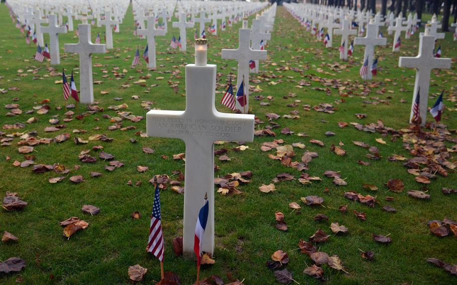 Candles glow on crosses at the Meuse-Argonne American Cemetery at Romagne-sous-Montfaucon, France, as Americans and French marked the 100th anniversary of the World War I Meuse-Argonne Offensive. The American Battle Monuments Commission planned a luminary at the cemetery, but wind and heavy rains caused the event to be canceled.