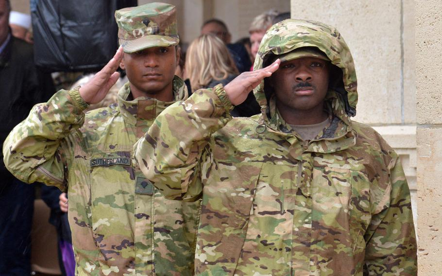 Spc. Damion Sutherland, left, of 212th Combat Support Hospital and Spc. Kalev Baker of the Medical Support Unit-Europe salute during the playing of the French version of taps at the ceremony marking the 100th anniversary of the World War I Meuse-Argonne Offensive at Meuse-Argonne American Cemetery at Romagne-sous-Montfaucon, France, Sunday, Sept. 23, 2018