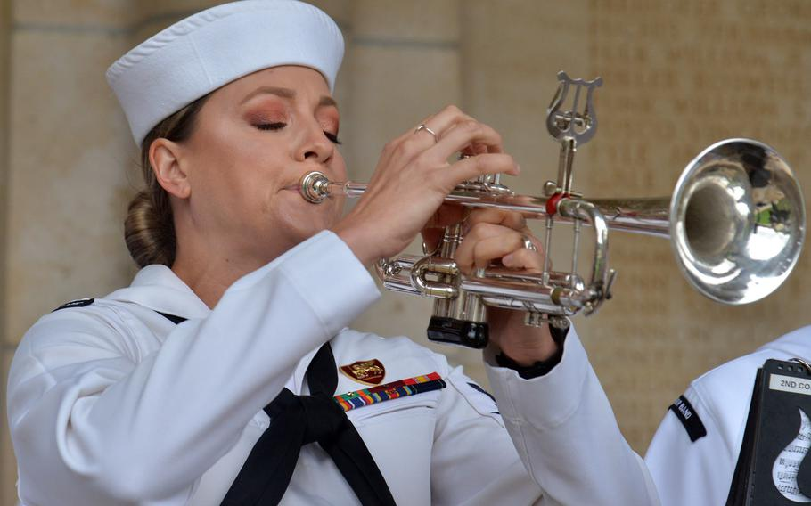 Petty Officer 2nd Class Kristen Gale of the U.S. Naval Forces Europe Band plays taps at the ceremony marking the 100th anniversary of the World War I Meuse-Argonne Offensive at Meuse-Argonne American Cemetery at Romagne-sous-Montfaucon, France, Sunday, Sept. 23, 2018.
