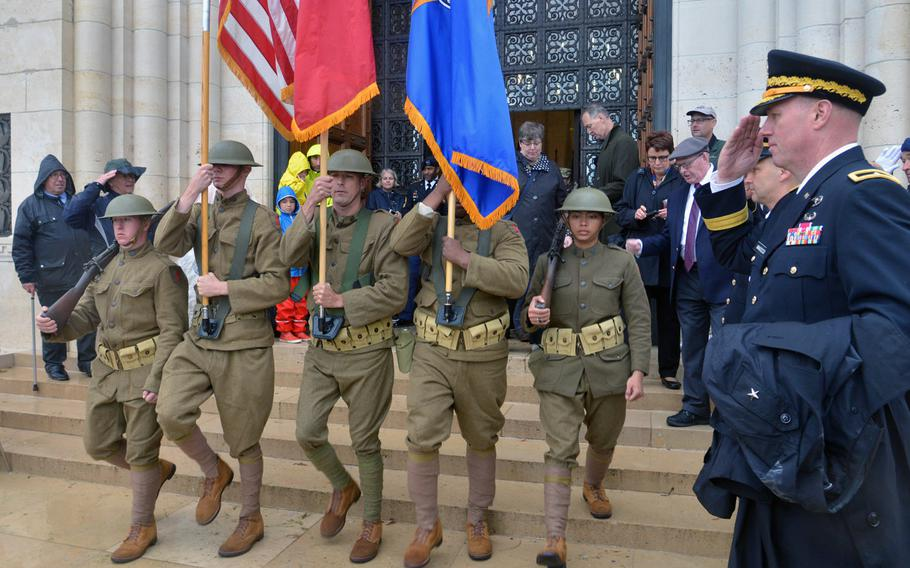 Dressed in World War I-style uniforms, the honor guard marches out of the chapel after the ceremony marking the 100th anniversary of the World War I Meuse-Argonne Offensive at Meuse-Argonne American Cemetery at Romagne-sous-Montfaucon, France, Sunday, Sept. 23, 2018.