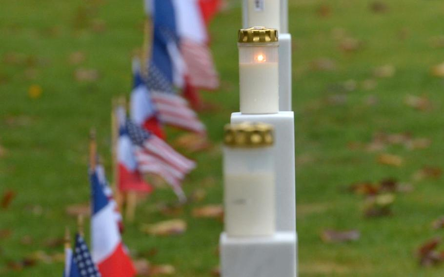 Candles glow on a row of crosses at the Meuse-Argonne American Cemetery at Romagne-sous-Montfaucon, France, as Americans and French marked the 100th anniversary of the World War I Meuse-Argonne Offensive. The American Battle Monuments Commission planned a luminary at the cemetery where candles were placed on its more than 14,000 graves. But wind and heavy rains cancelled the event.