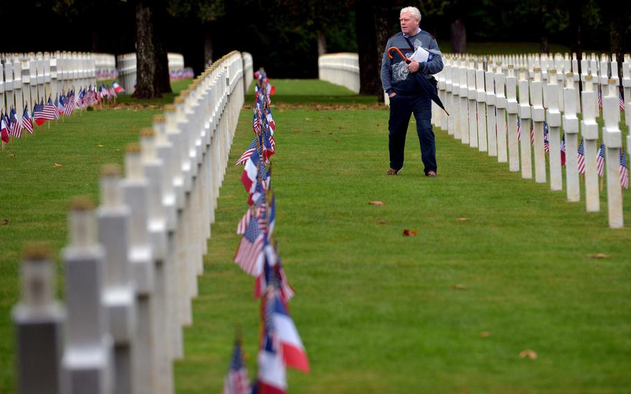 A man walks through the Meuse-Argonne American Cemetery at Romagne-sous-Montfaucon, France, Sunday, Sept. 23, 2018, following a ceremony marking the 100th anniversary of the World War I Meuse-Argonne Offensive.