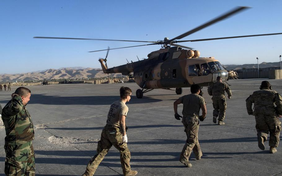 Medical team members rush toward an Afghan Mi-17 helicopter with wounded soldiers aboard in Faryab province, Afghanistan, August 27, 2018. The U.S.-led coalition is adjusting tactics in light of mounting casualties among local security forces, Defense Secretary Jim Mattis said on Monday at the Pentagon.
