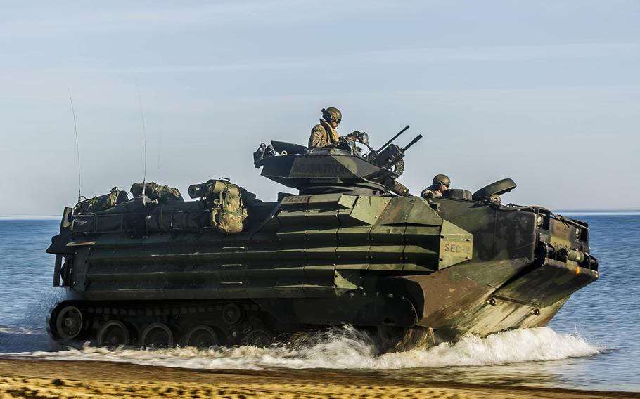 U.S. Marines of the 26th Marine Expeditionary Unit drive an AAV-P7/A1 assault amphibious vehicle to a staging in preparation for operations during Baltic Operations 2018 in Ustka, Poland, June 8, 2018. Instead of extending the service life of the AAV, which has been in use since 1972, the Marines will speed up production of the new amphibious combat vehicle.