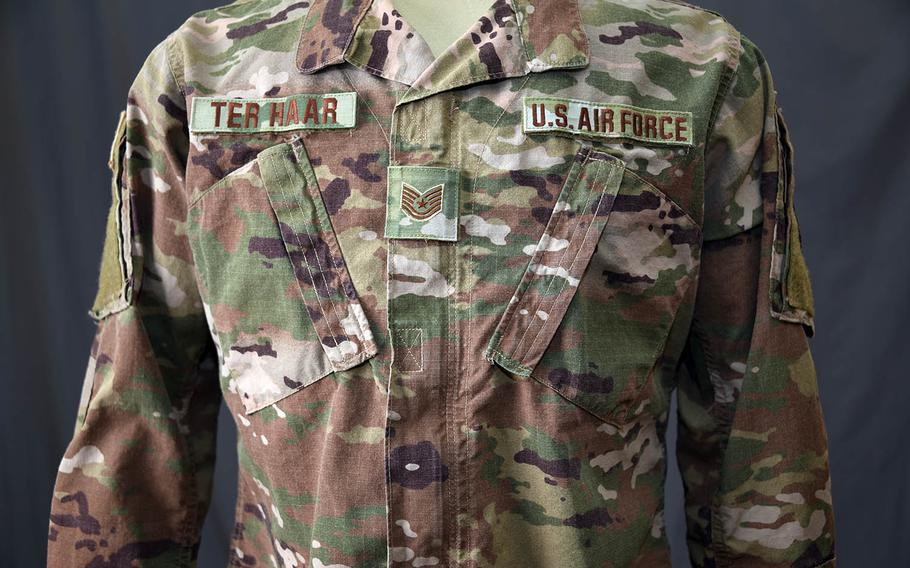 """The Operational Camouflage Pattern uniform has a """"hook and loop"""" rank displayed in the middle of the chest."""