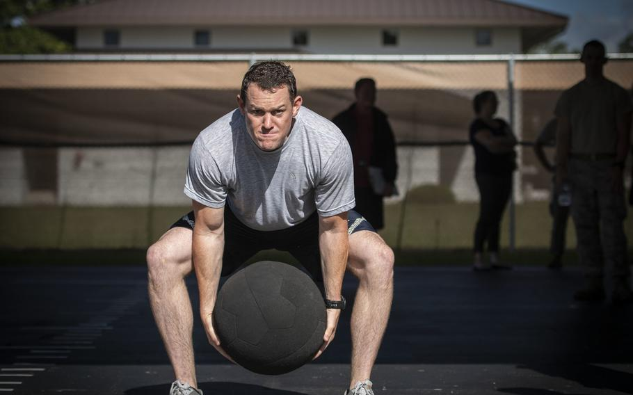 Tech. Sgt. Cole Carroll-Grandegenett, 52nd Civil Engineer Squadron, Spangdahlem Air Base, Germany, performs an over-head medicine ball throw during the beta test of the Explosive Ordnance Disposal Tier 2 fitness test prototype, Sept. 10, 2018, at Eglin Air Force Base, Fla.  e