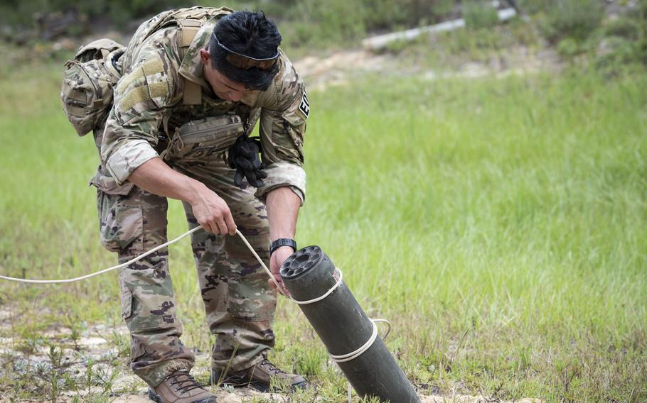 An explosive ordnance disposal airman removes a rocket after a simulated attack during the operational phase of the beta test of the EOD Tier 2 fitness test prototype, Sept. 10, 2018, at Eglin Air Force Base, Fla.