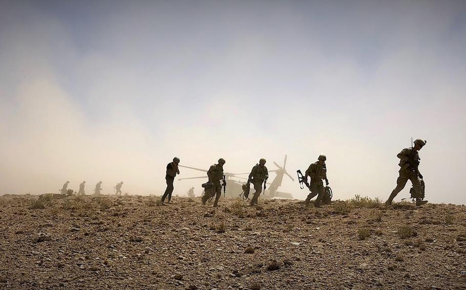 Soldiers from 2nd Squadron, 1st Calvary Regiment, 1st Stryker Brigade Combat Team, 4th Infantry Division dismount a UH-60 Blackhawk in preparation for a foot patrol in Afghanistan, Sept. 4, 2018.