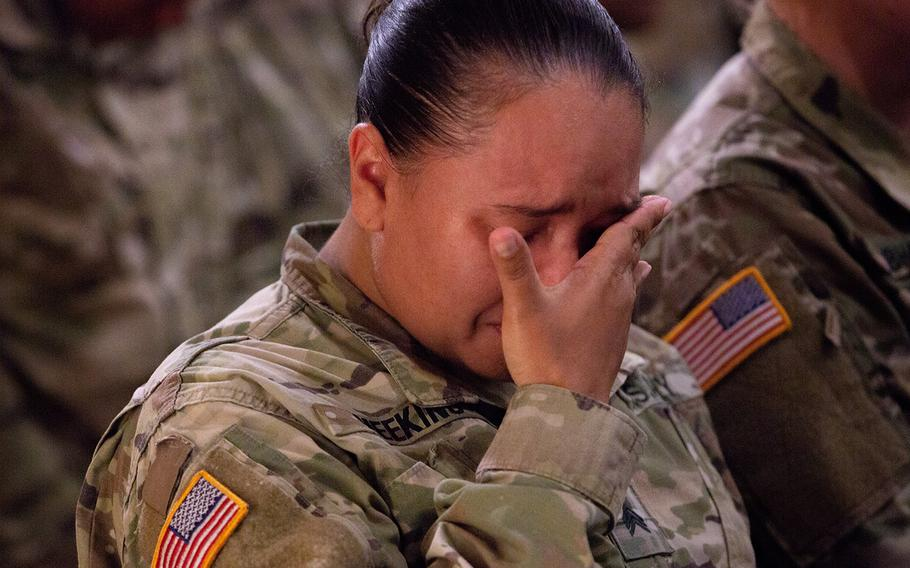 A soldier mourns Pfc. Adrienne Barillas at the Warrior Chapel on Camp Humphreys, South Korea, Monday, Oct. 1, 2018.