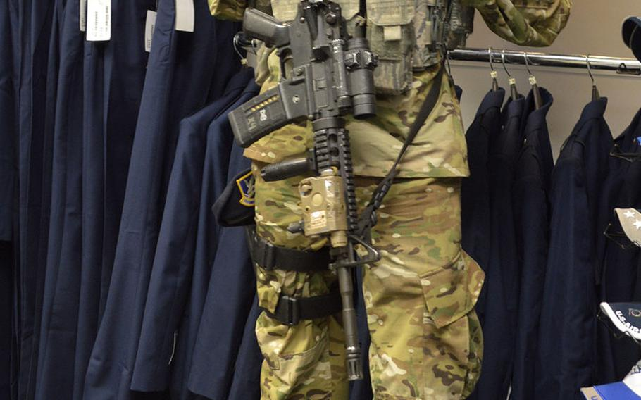 Airman 1st Class Brandon Shank, a Security Forces airman with the 31st Security Forces Squadron, 31st Fighter Wing, Aviano Air Base, Italy, provides security at the Base exchange clothing shop, Monday, Oct. 1, 2018. Aviano is one of the first Air Force bases to begin selling the new Operational Camouflage Pattern uniform.