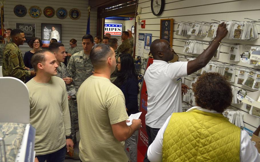 Airmen at Aviano Air Base's military clothing store shop for items required for their new Operational Camouflage Pattern uniforms, Monday, Oct. 1, 2018. Aviano is one of the first Air Force bases to begin selling the new OCP uniform.