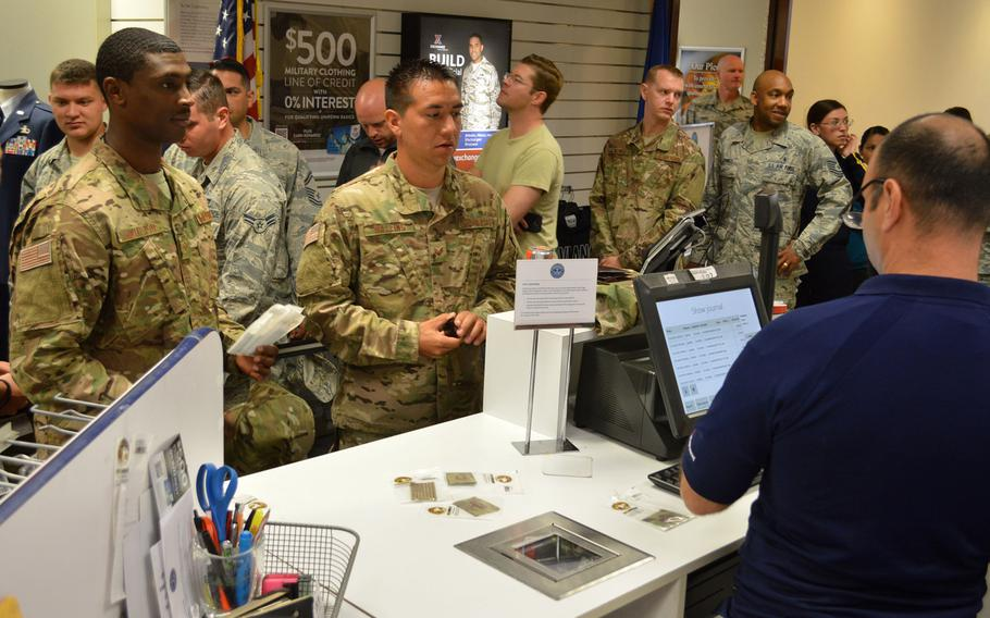 Airmen at Aviano Air Base's military clothing shop purchase items to go with their new Operational Camouflage Pattern uniforms, Monday, Oct. 1, 2018.