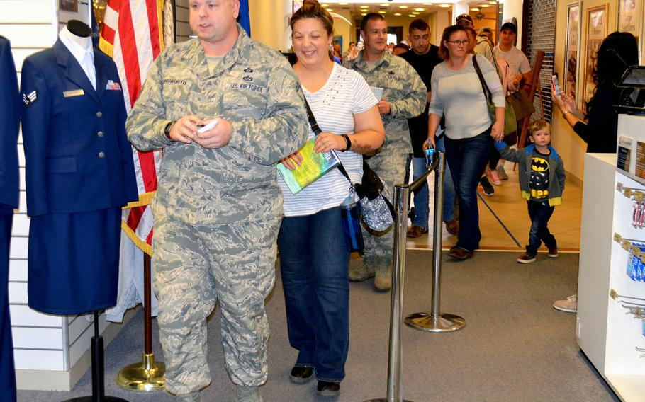 Airmen at Aviano Air Base enter the military clothing shop after waiting in line for more than an hour to purchase their new Operational Camouflage Pattern uniforms, Monday, Oct. 1, 2018. Aviano is one of the first Air Force bases to begin selling the new OCP uniform.