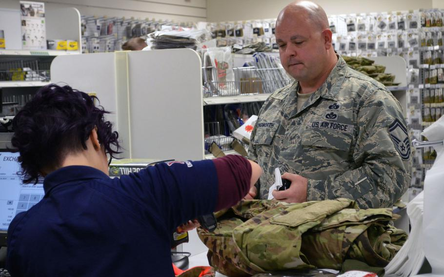Senior Master Sgt.Thomas E. Longworth, a Readiness and Emergency Management specialist with the 31st Civil Engineering Squadron, 31st Fighter Wing, Aviano Air Base, Italy, purchases the new Operational Camouflage Pattern uniform at the base's military clothing shop, Monday, Oct. 1, 2018.