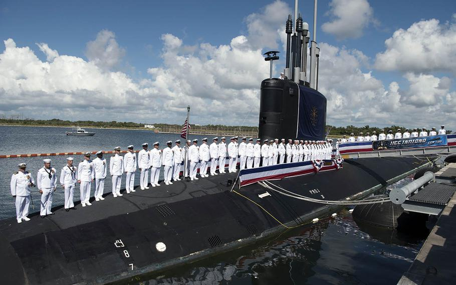 The crew of the USS Indiana stands at attention during the submarine's commissioning ceremony in Port Canaveral, Fla., Sept. 29, 2018.