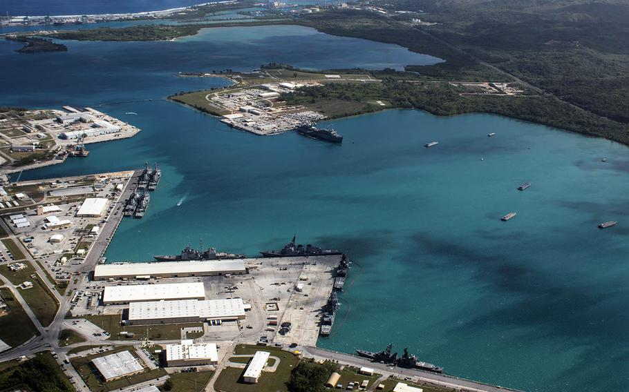 This aerial view of Naval Base Guam shows Apra Harbor with several vessels in port on March 5, 2016.