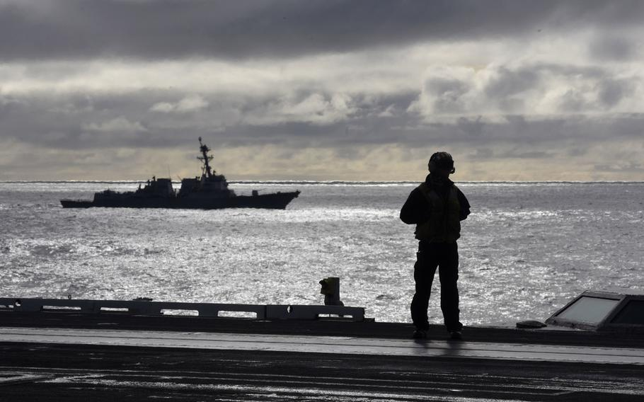 A sailor stands on the flight deck during flight operations aboard the aircraft carrier USS Harry S. Truman in the North Atlantic, Sept. 18, 2018. The Harry S. Truman Carrier Strike Group is deployed to the U.S. 6th Fleet area of operations.