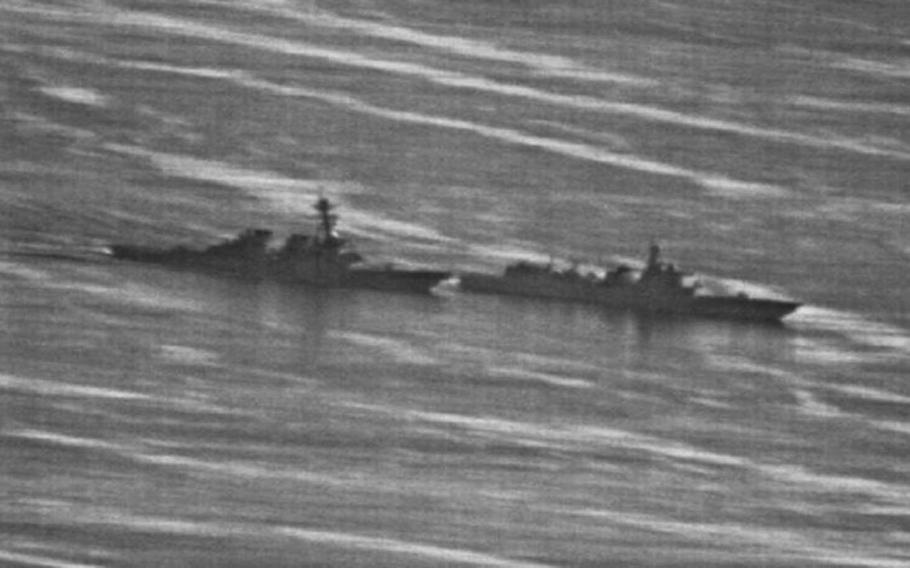 This Navy image obtained by naval website gCaptain.com shows a confrontation between the USS Decatur, left, and a Chinese destroyer in the South China Sea, Sunday, Sept. 30, 2018.